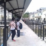 Wajihah and Rimey on a walkway at the new housing area of Kampong Ayer